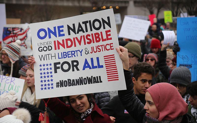 no immigration ban sign