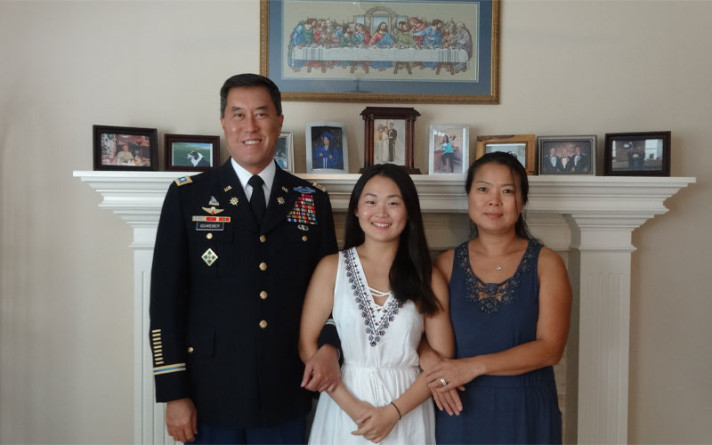 Lt. Col. Patrick Schreiber and Soo Jin Schreiber brought their niece Hyebin, center, to the U.S. from South Korea when she was 15, and adopted her at 17. Federal officials argue she's not eligible for citizenship. Photo: Sharma-Crawford Attorneys at Law